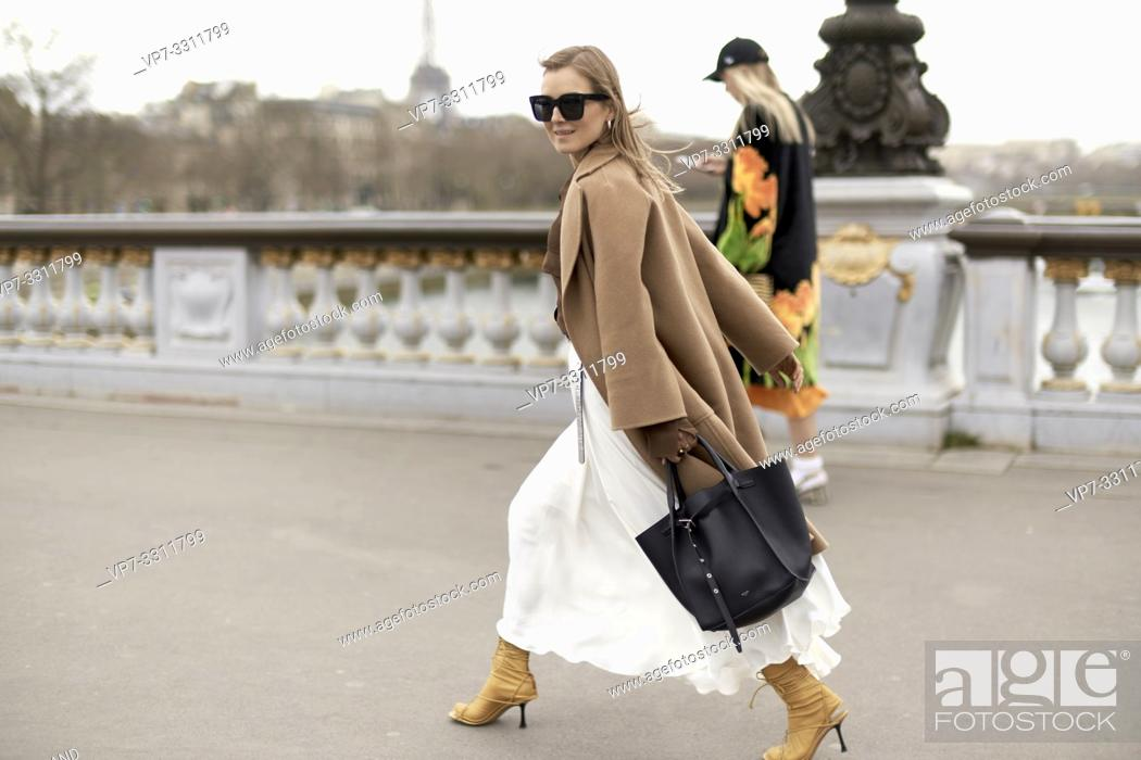 Stock Photo: fashionable blogger woman walking in city Paris, France.