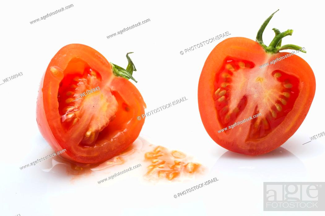 Stock Photo: cut tomato on white Background.