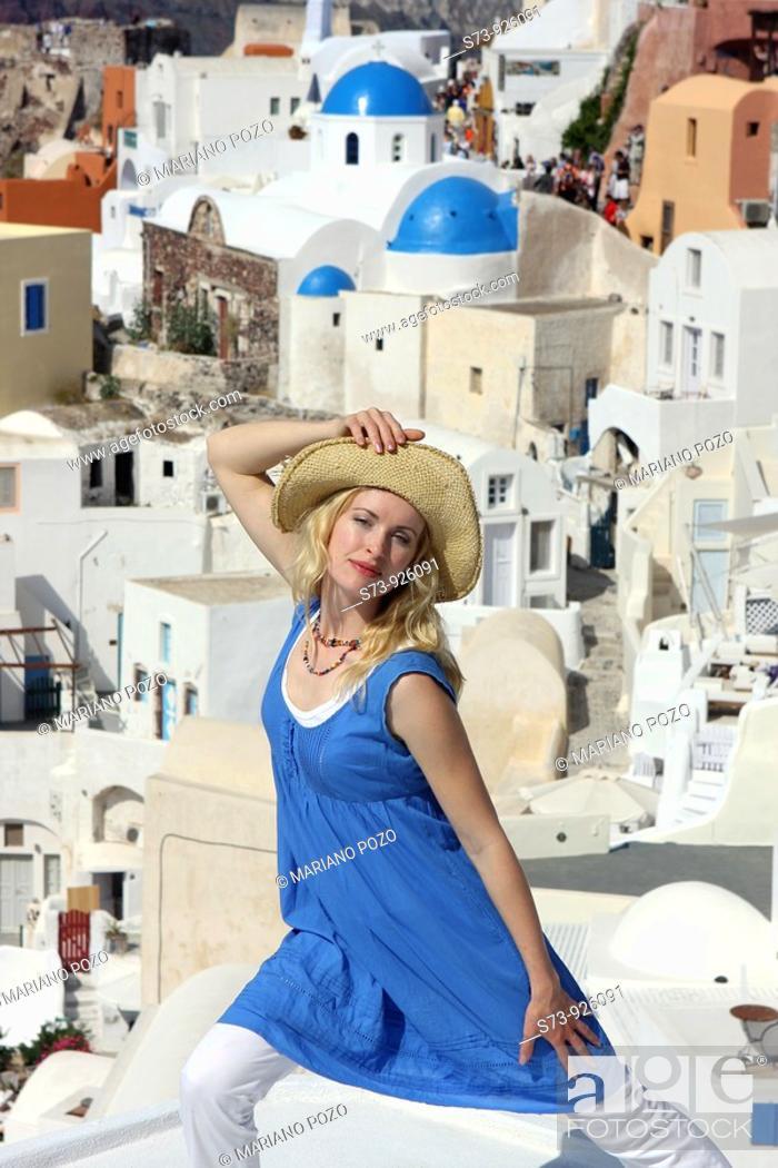 Stock Photo: Woman in Oia, Santorini, Cyclades Islands, Greece.