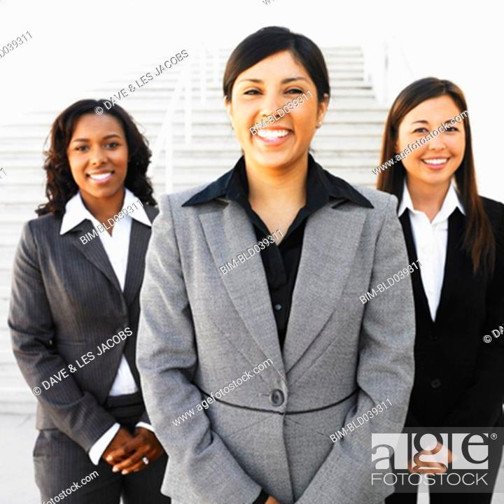 Stock Photo: Ethnic-ethnic businesswomen next to outdoors stairs.