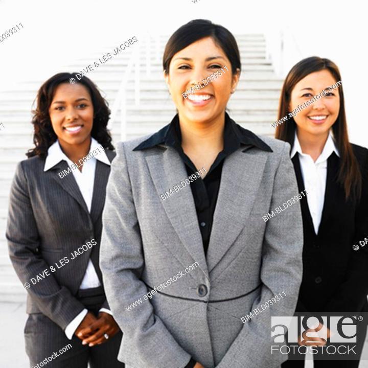 Stock Photo: Ethnic-ethnic businesswomen next to outdoors stairs.