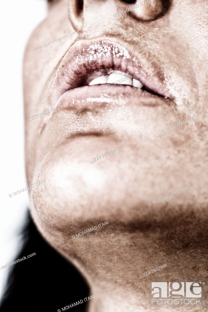 Stock Photo: Close up of a young woman's chin.