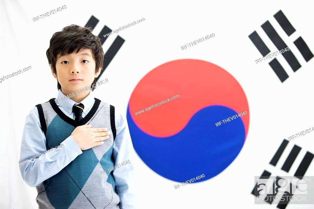 Stock Photo: boy in front of Korean flag, Taegeukgi.