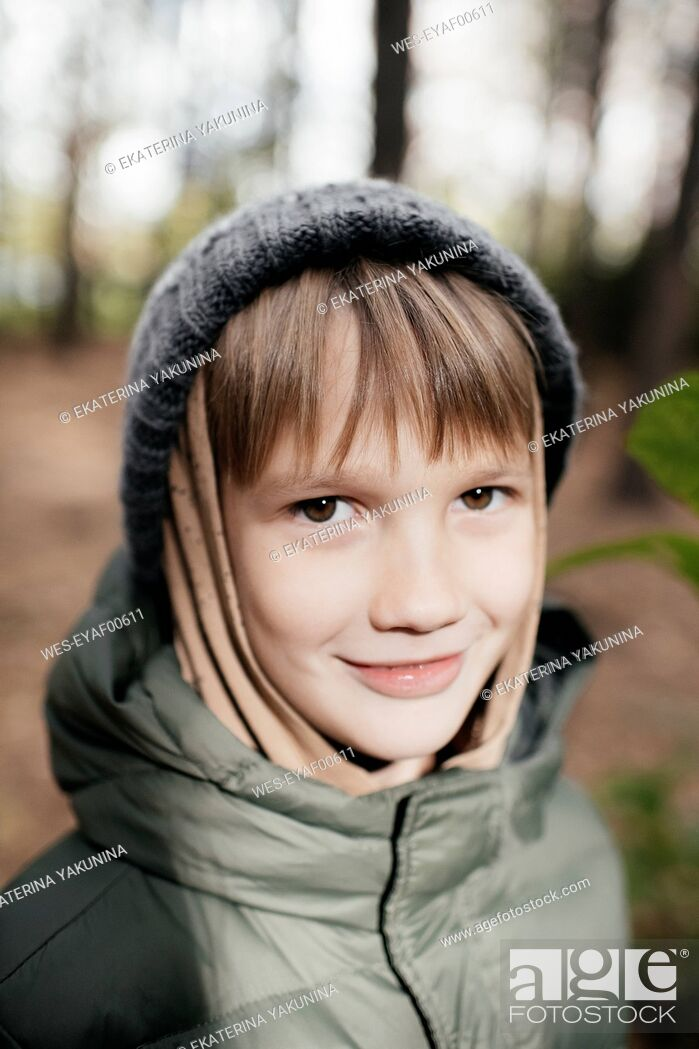 Stock Photo: Portrait of a boy in autumnal park.