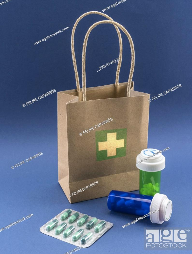 Stock Photo: Several medicines with a cardboard bag, conceptual image.