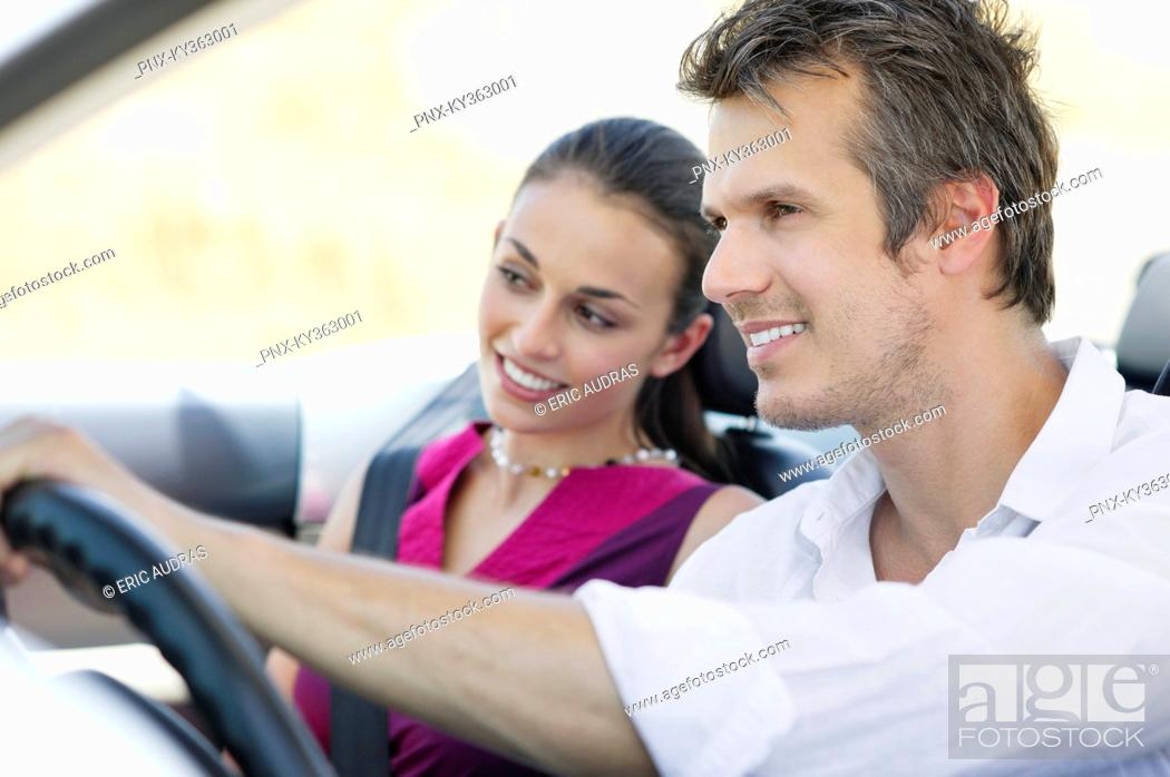 Stock Photo: Couple driving a convertible car.