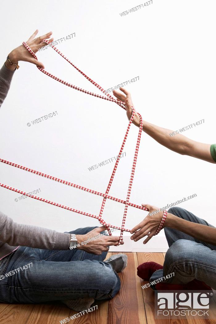 Stock Photo: Two men stretching rope.