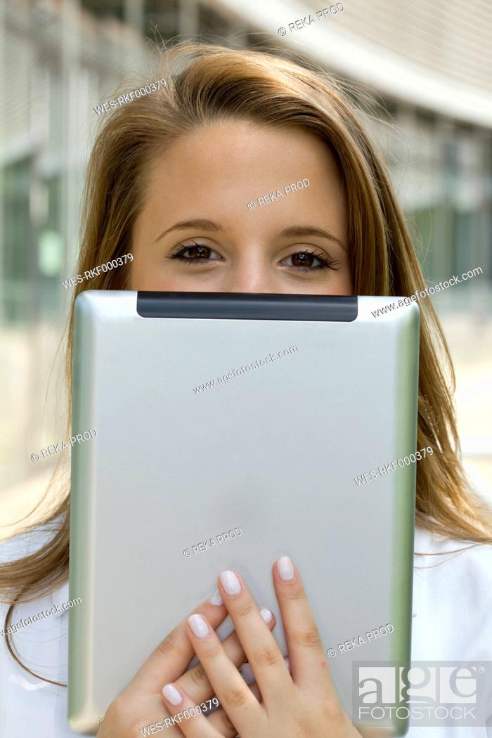 Stock Photo: Europe, Germany, North Rhine Westphalia, Duesseldorf, Medical student with digital tablet, portrait.