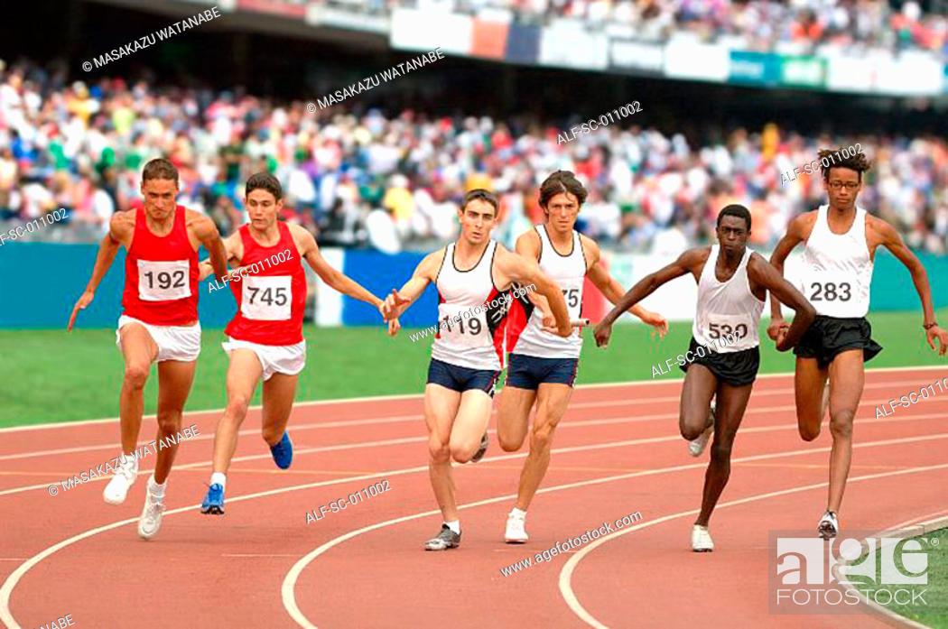 Stock Photo: Relay Runners Sprinting.
