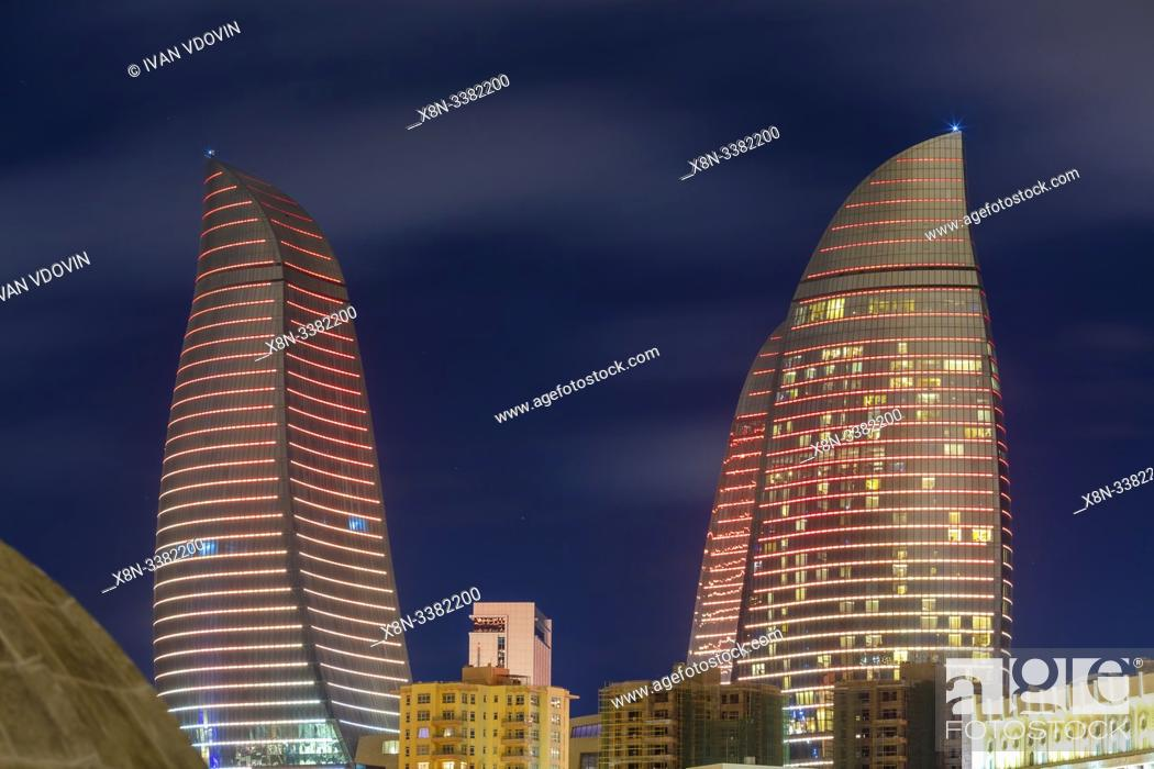 Stock Photo: Flame Towers skyscrapers at night, Baku, Azerbaijan.