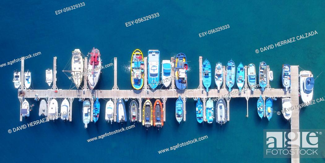 Stock Photo: Panoramic Aerial view on boats moored in the pier, drone shot directly above. High quality photo.