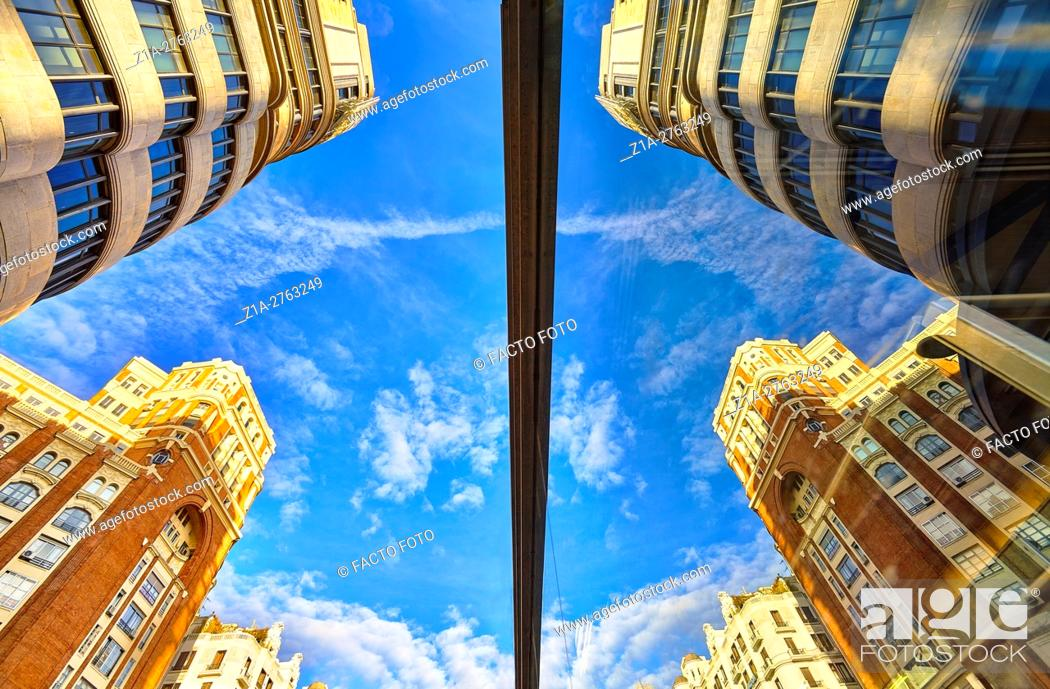 Imagen: Low angle view of Carrion building and Palacio de la Prensa at Callao square. Madrid. Spain.