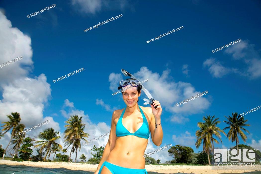 Stock Photo: Women with Snorkel on Beach.
