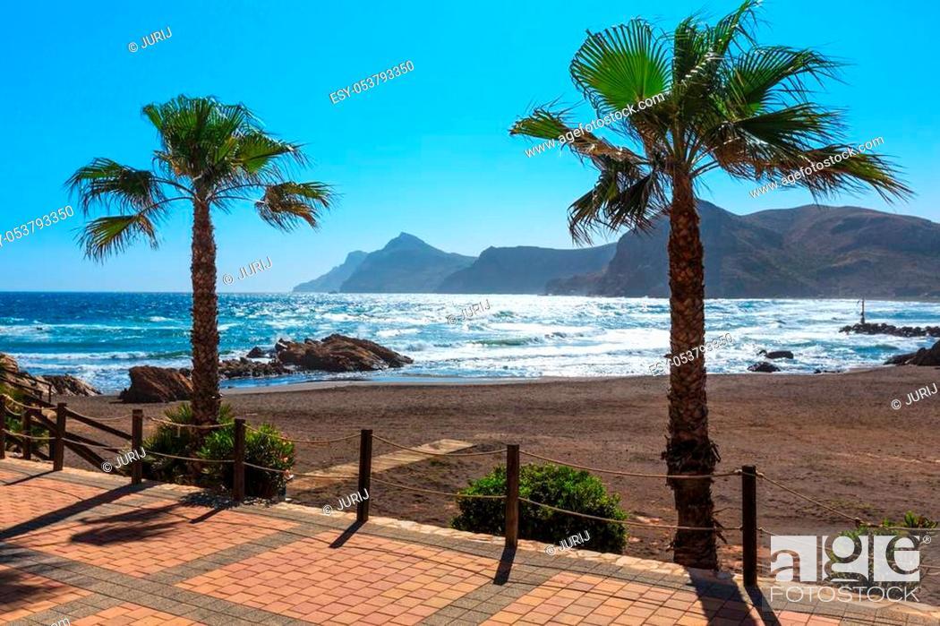 Stock Photo: Mediterranean sea summer coastline view with beach, footpath and palm trees (Portman bay, Costa Blanca, Spain).
