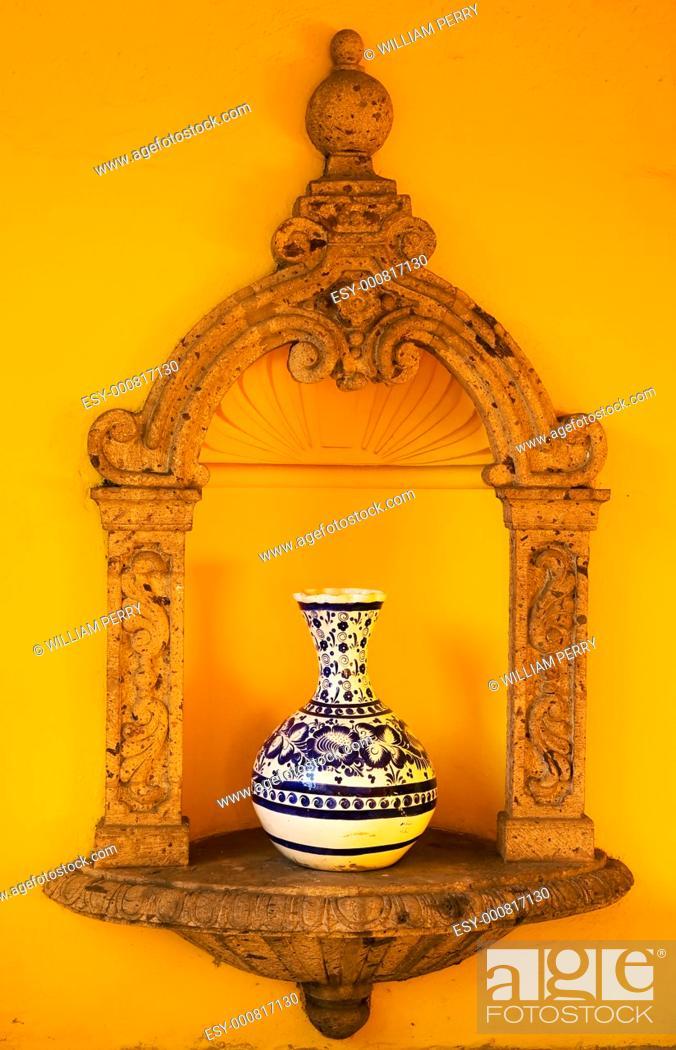 Stock Photo: Yellow Adobe Wall, Blue White Mexican Vase, Guadalajara Mexico.