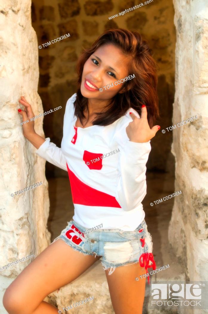 Stock Photo: Attractive Asian woman on location in Fort San Pedro, Cebu, Philippines.