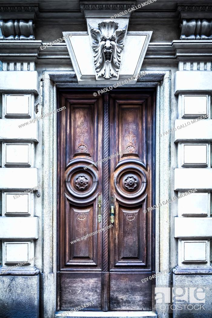 Stock Photo: Italy, Turin. This city is famous to be a corner of two global magical triangles. This old door has been guarded by a gargoyle in last hundred years.