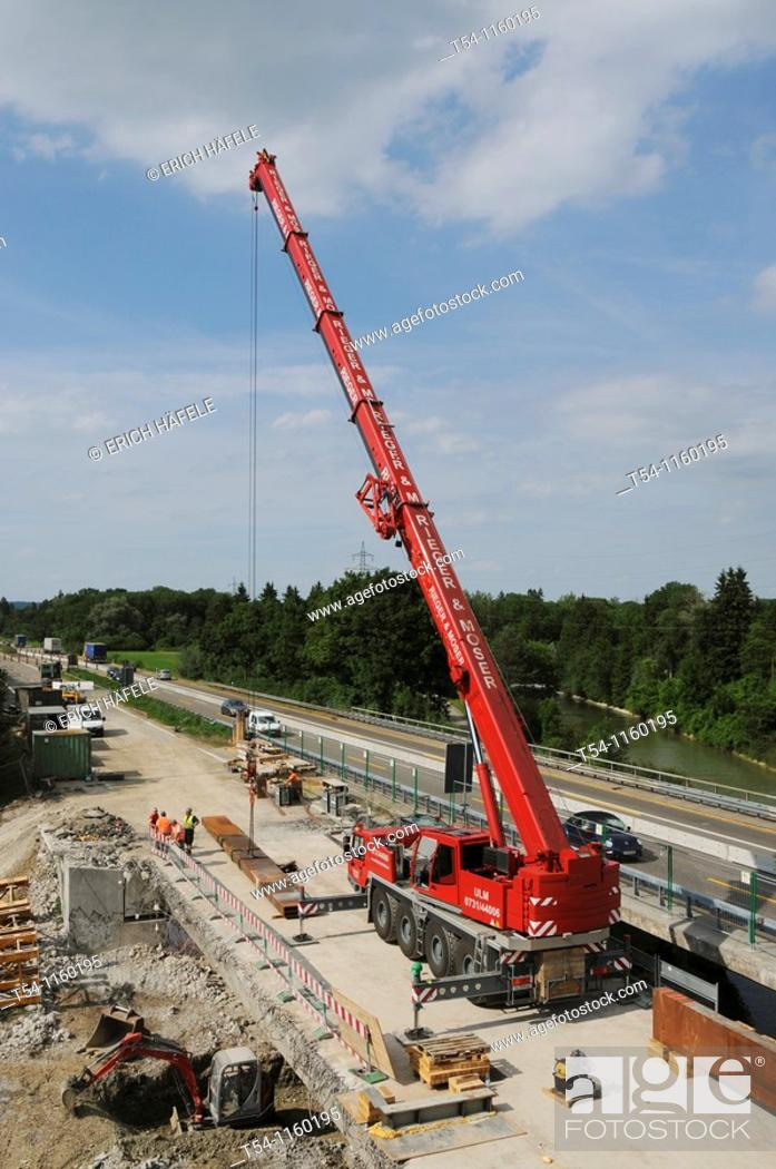 Stock Photo: Crane on a highway construction site.
