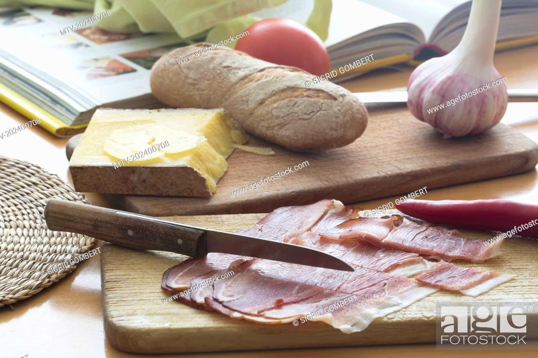 Stock Photo: Close-up of slices of ham and vegetables in the kitchen.