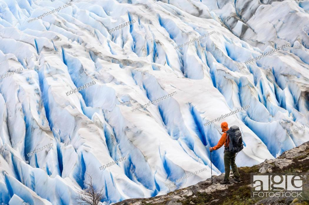Stock Photo: Man by Grey Glacier near Campamento Los Guardas, Torres del Paine National Park, Chile.