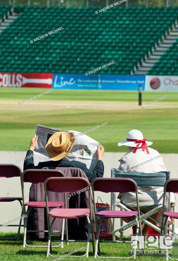 Stock Photo: A very English scene at Cheltenham's cricket ground, Gloucestershire, UK.