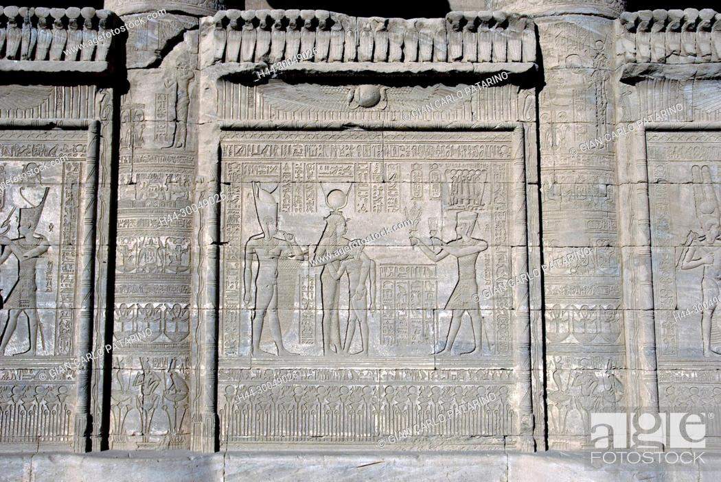 Stock Photo: Dendera Egypt, ptolemaic temple dedicated to the goddess Hathor. Carvings on external wall of mammisi.
