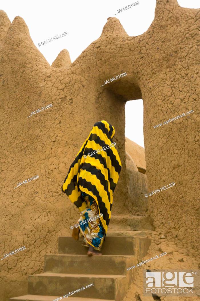 Stock Photo: Woman outside Mud Mosque in Segoukoro, Segou, Mali.