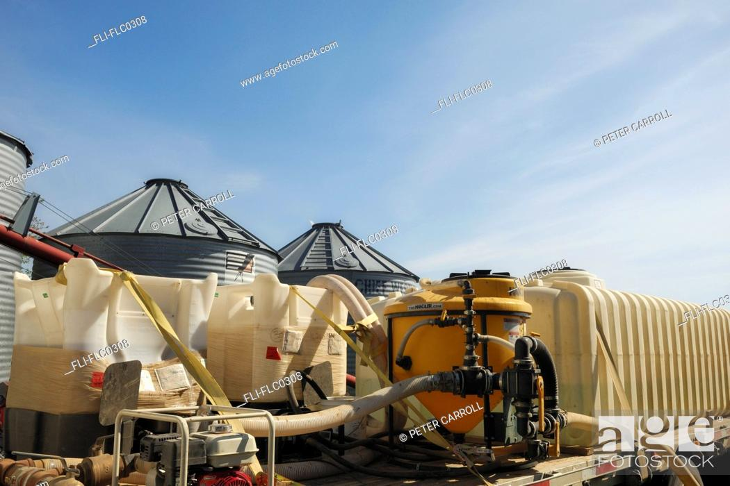 Stock Photo: Chemicals used by farmer in preparing his field for seeding near Mundare, Alberta.