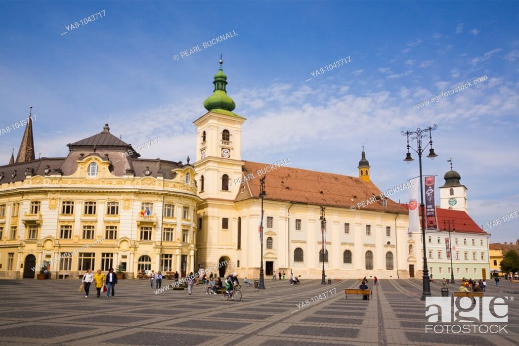 Stock Photo: Sibiu Transylvania Romania Europe  Roman Catholic church of the Holy Trinity and old buildings in Piata Mare pedestrianised square in historic city centre of.