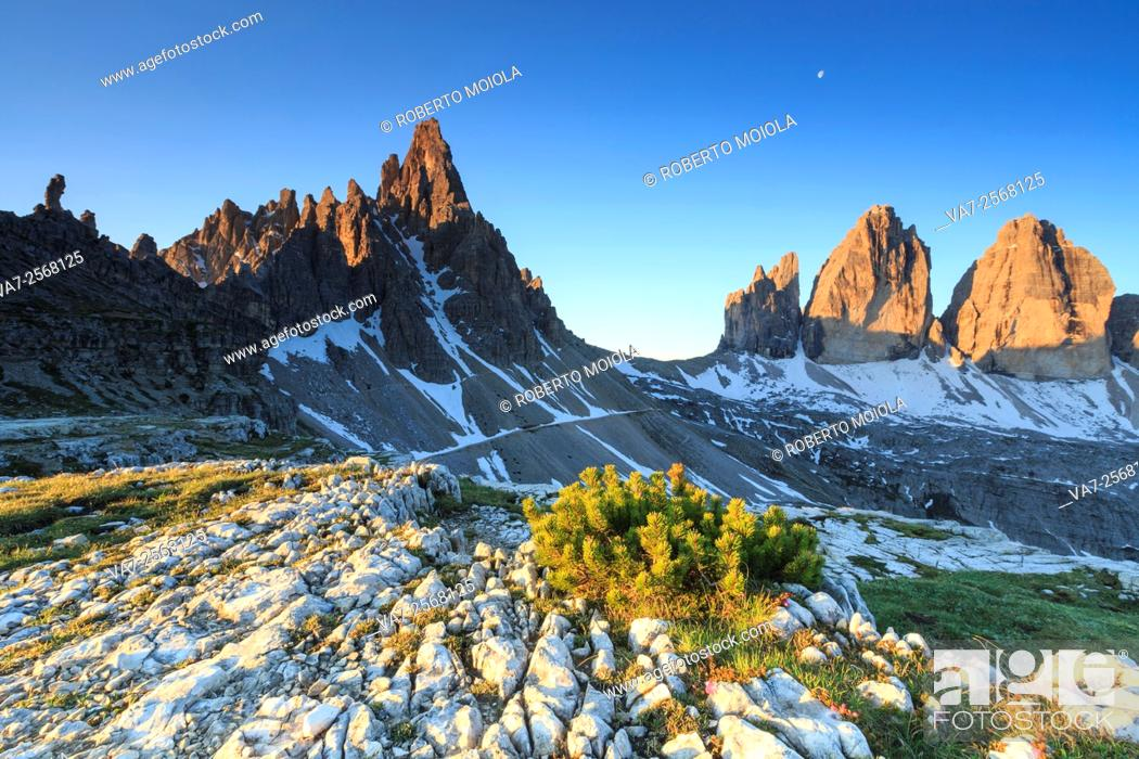 Stock Photo: Dawn illuminates the Three peaks of Lavaredo and Mount Paterno. Sesto Dolomites Trentino Alto Adige Italy Europe.
