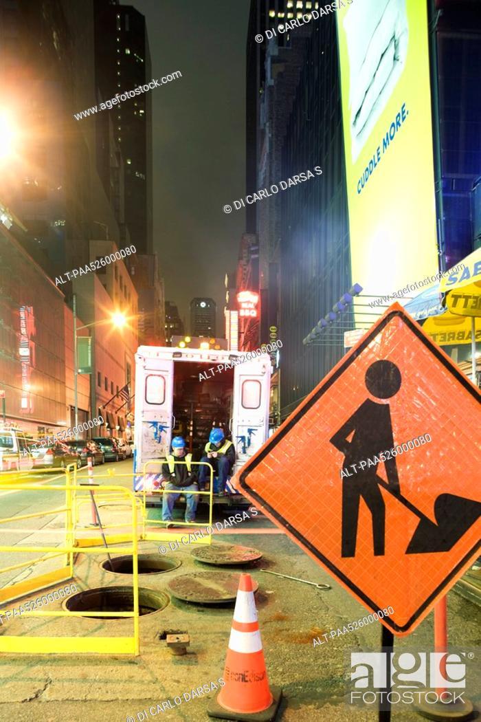 Stock Photo: City workmen taking break from work on W 42nd Street near Times Square, New York City.