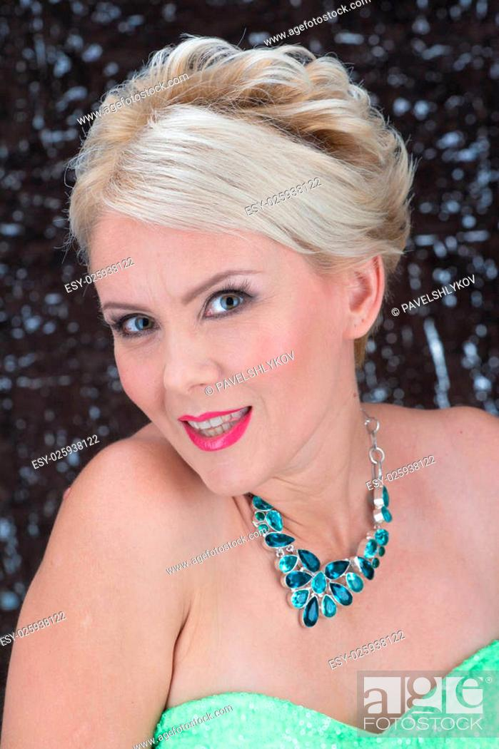 Stock Photo: Closeup portrait of adult woman beautiful face with perfect makeup and necklace.