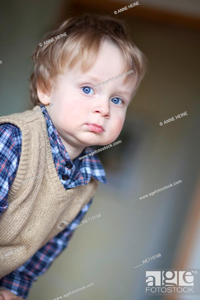 Stock Photo: portrait of 1 year old boy looking into distance, thoughtful.