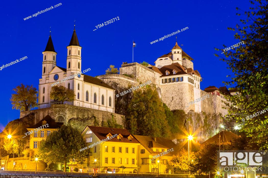 Stock Photo: Castle and chuurch in Aarburg at night over river Aare, Kanton Aargau, Switzerland.