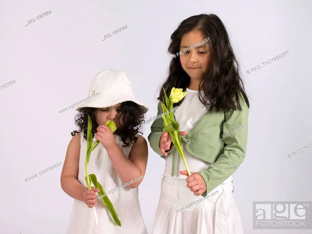 Stock Photo: Two girls holding a flower.