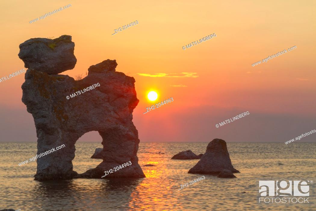 Stock Photo: The rauk 'The dog' in sunset on Fårö on Gotland, Sweden.