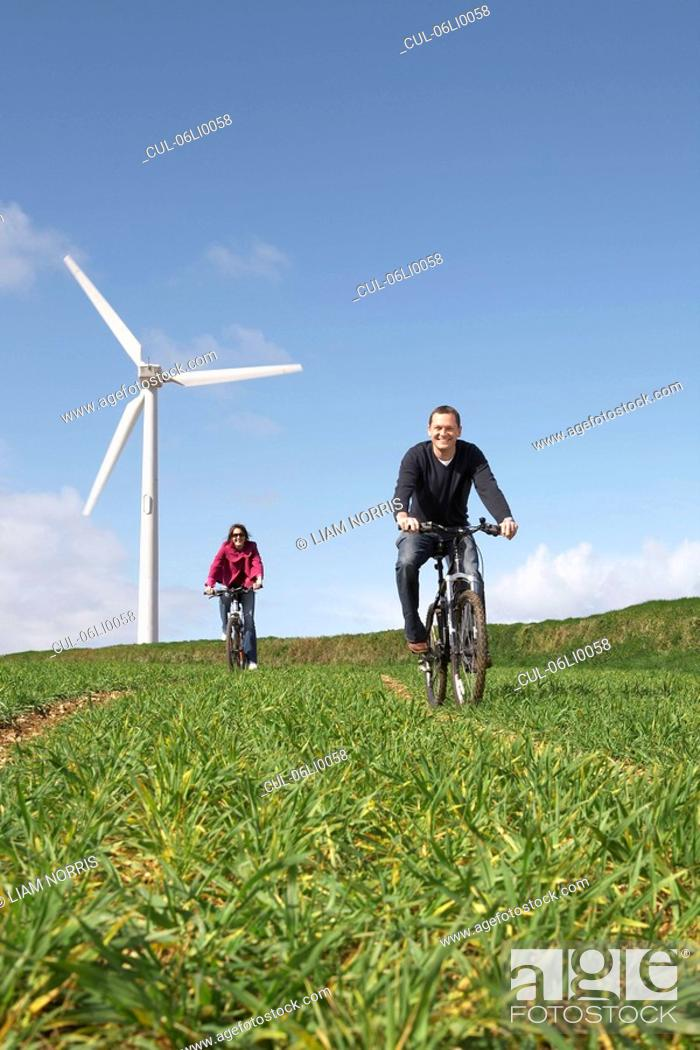 Stock Photo: Couple riding bikes.