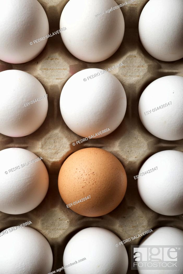Stock Photo: Chicken eggs in a cardboard box.