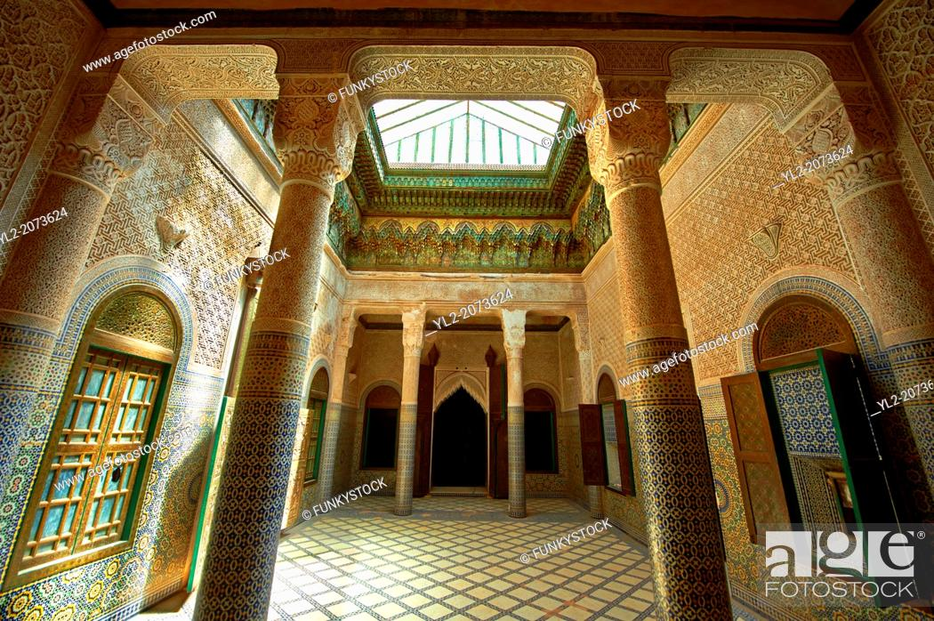 Stock Photo: Berber Muqarnas Arabesque stalactite plaster work ceiling and Mocarabe Honeycomb work plaster columns and capitals of the inner courtyard of the Kashah of.