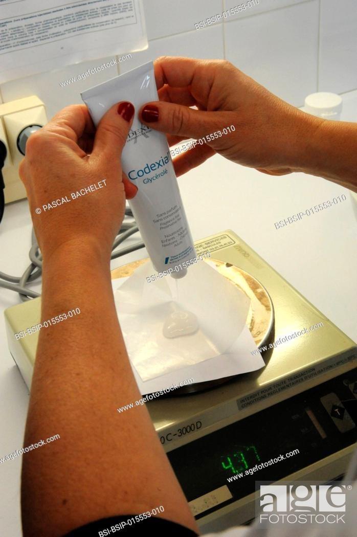 Stock Photo: Reportage in a pharmacy in Auxi-le-Château, France. A pharmacy technician prepares a glycerol starch-based treatment.