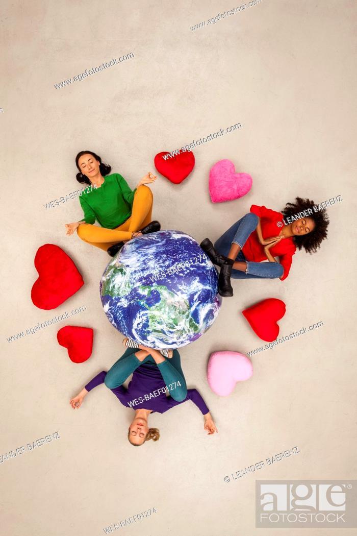 Stock Photo: Three women meditating for the world.