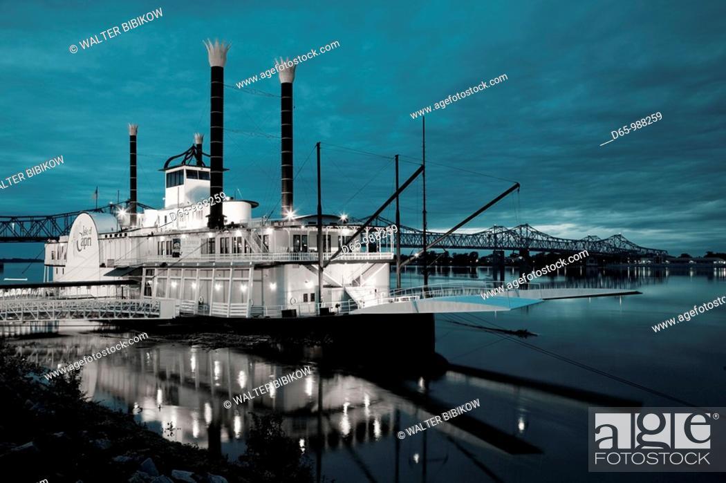 Stock Photo: USA, Mississippi, Natchez, Isle of Capri Casino riverboat on Mississippi River, dusk.