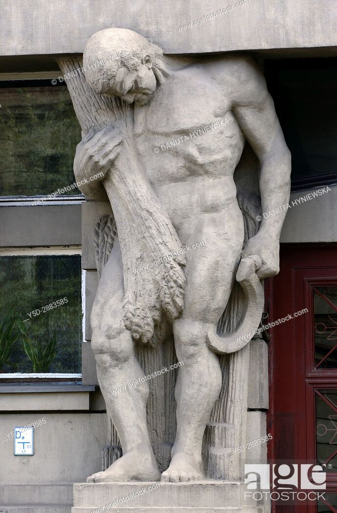 Stock Photo: Atlante - one of five full size statues in entrance to tenement house Narutowicza street number 45 built in 1913, Lodz, Poland, Europe.