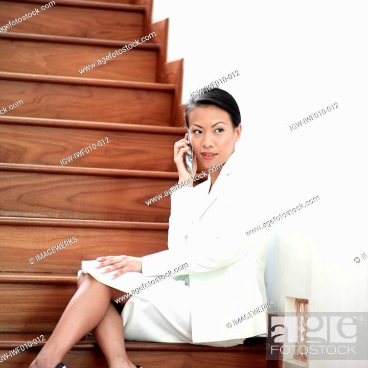 Stock Photo: Side profile of a businesswoman talking on a mobile phone.