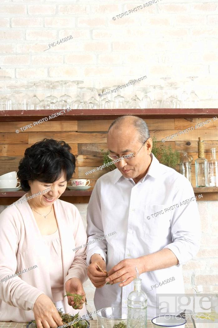 Stock Photo: Senior Couple at the Kitchen,Korea.