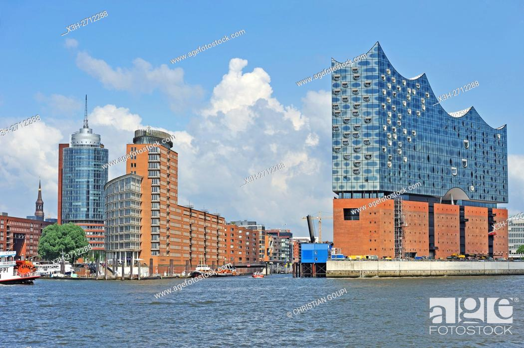 Stock Photo: Elbphilharmonie, a concert hall built on top of an old warehouse building (by Swiss architecture firm Herzog & de Meuron), view from a ferry on Elbe river.