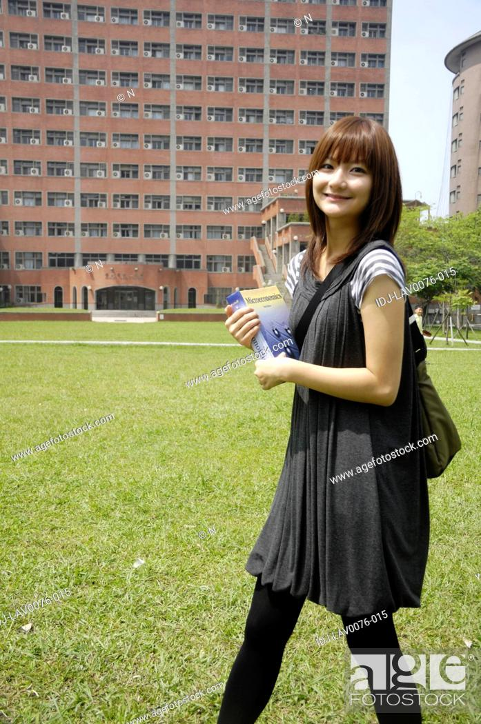 Stock Photo: Female university student walking in a campus.