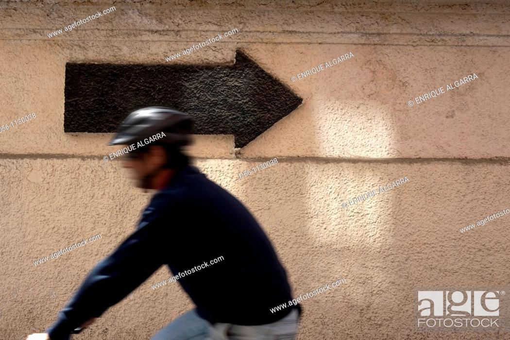 Stock Photo: Bicyclist and arrow, Valencia. Spain.