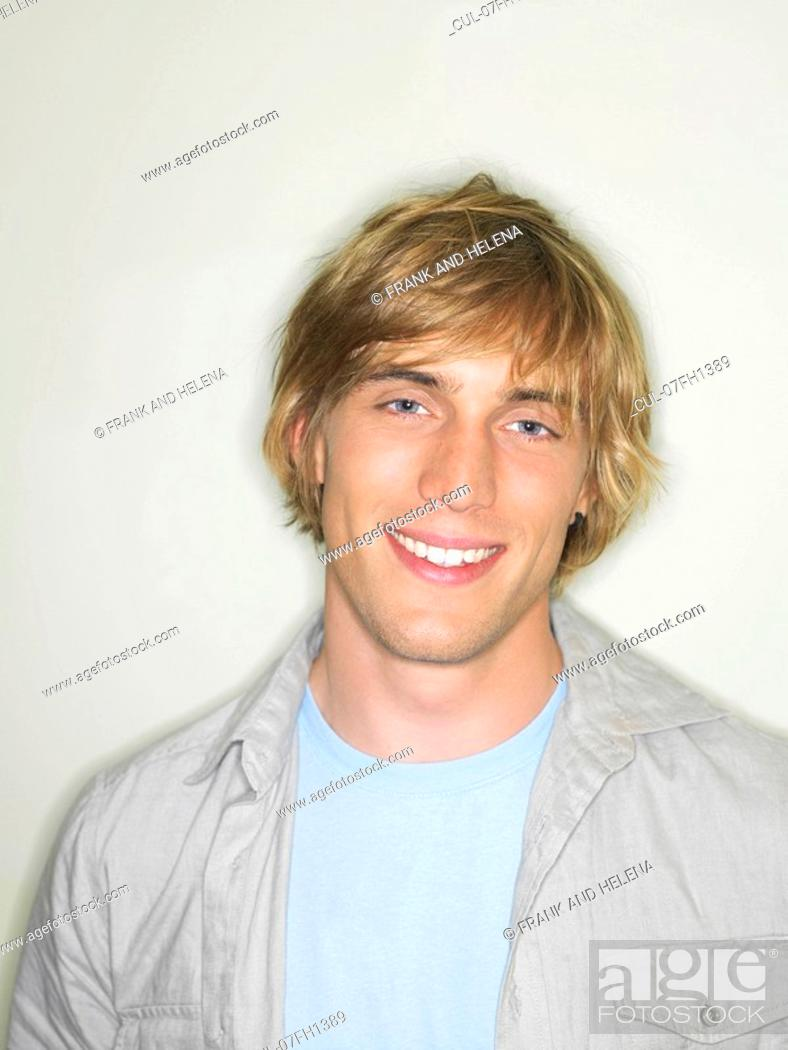 Stock Photo: Portrait of smiling young man.