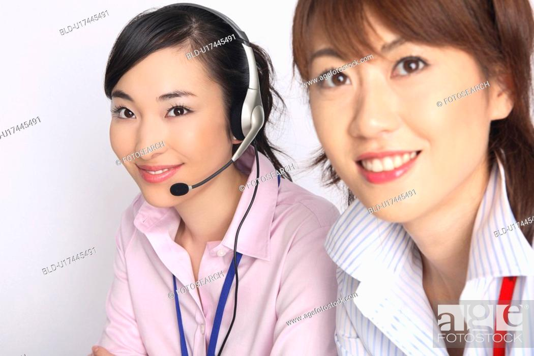 Stock Photo: Business lady talking in headset.